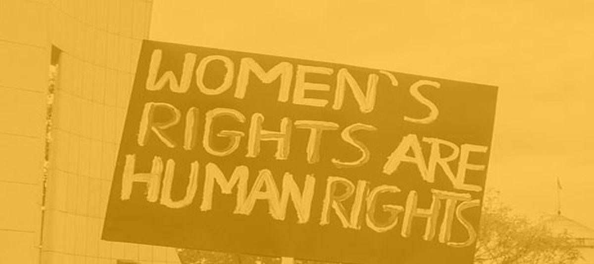 A protest sign reads, women's rights are human rights.